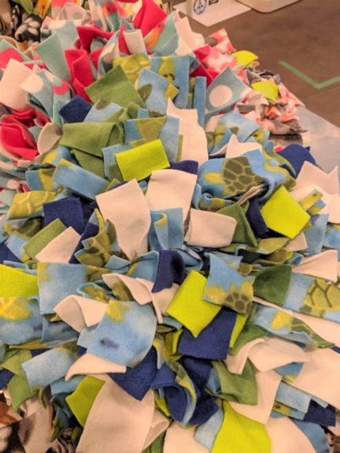 """Each snuffle mat is 12"""" x 12"""". Locally made in Durham, NC. Thick layers of fleece knots on a heavy, sturdy rubber backer."""