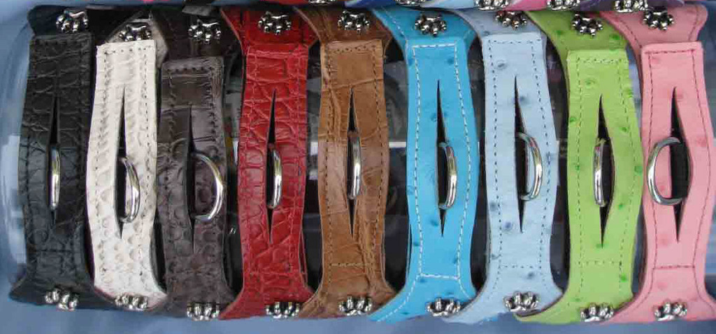 Croc Black (CBK), White (CWH), Chocolate (CCH), Red (CRD), Mocha (CMO); Ostrich Turquoise (OTU), Baby Blue (OBB), Lime Green (OLG), Pink (OPK) The Croc and Ostrich are finished on the top side and backed with a finished leather.  When new, the Croc Leather is stiff but after it is worn, it becomes very soft.  The pet owner can speed up the softening process by working the Croc Leather by hand prior to placing on the pet.