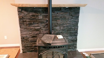 "NW Stacked Stone Kodiak. This fireplace is from a new construction job. This is a panelized product that comes in 4"" x 20"" panels. Easy to install and adds value to your home."