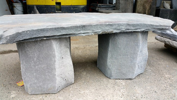 "This garden bench would make a great addition to any garden or patio area. It is made of lightweight concrete but looks like stone. The edges are incredible. 42""w x 16"" d x14"" h."