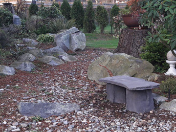 This garden bench would make a great addition to any garden or patio area. It is made of lightweight concrete but looks like stone. The edges are incredible.
