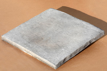 24x24x 1 3/4 us as a paver or column cap. Also available as smooth.  Color shown slate. We can make in any color you wish.
