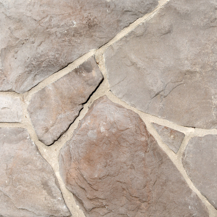 "Field Stone Dungeness Fieldstone is a random stone veneer that has a timeless look.  Sizes range in diameter from 3""to 24""."