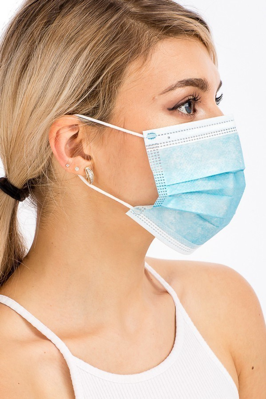 Blue Disposable Surgical Face Masks Showing Side View of Model Wearing Blue Disposable Face Mask