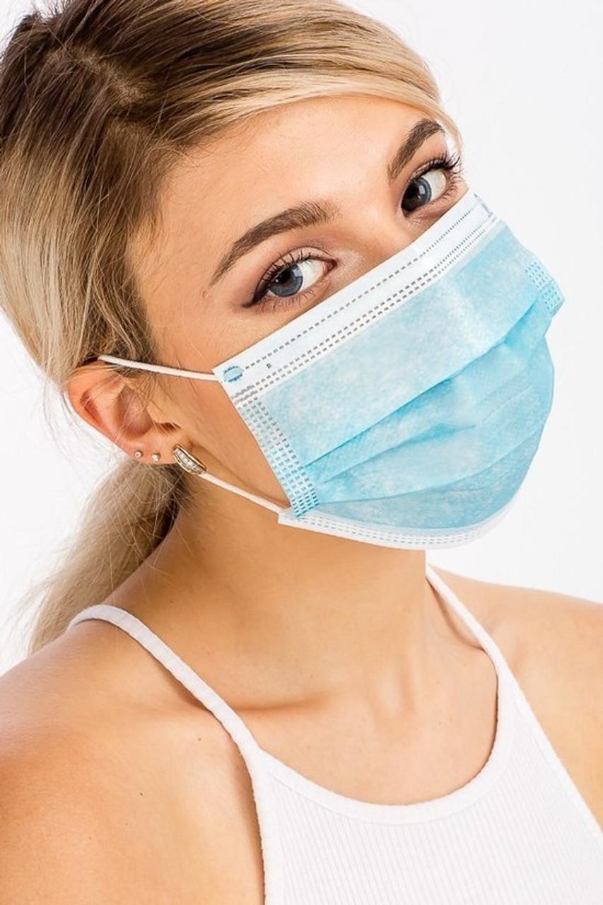 Blue Disposable Surgical Face Masks Showing Front View of Model Wearing Blue Disposable Face Mask