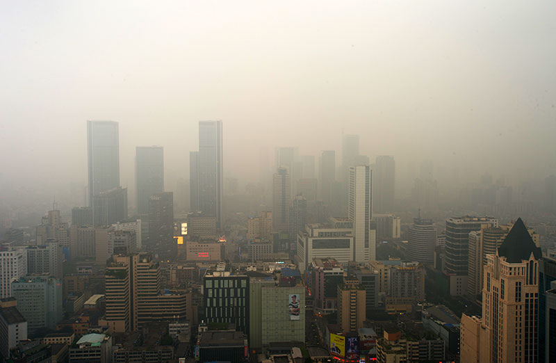 Air pollution over a city skyline showing how bad the health risks are to your lungs