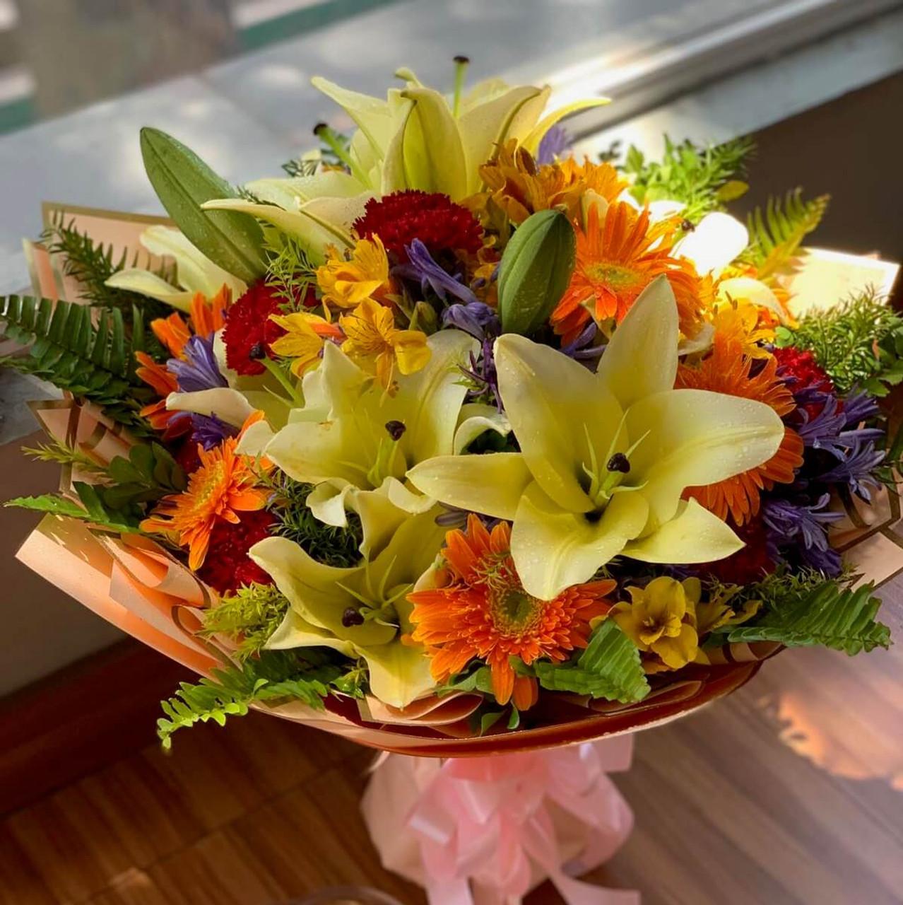 Sunburst Lilies Carnations Daisies Bouquet