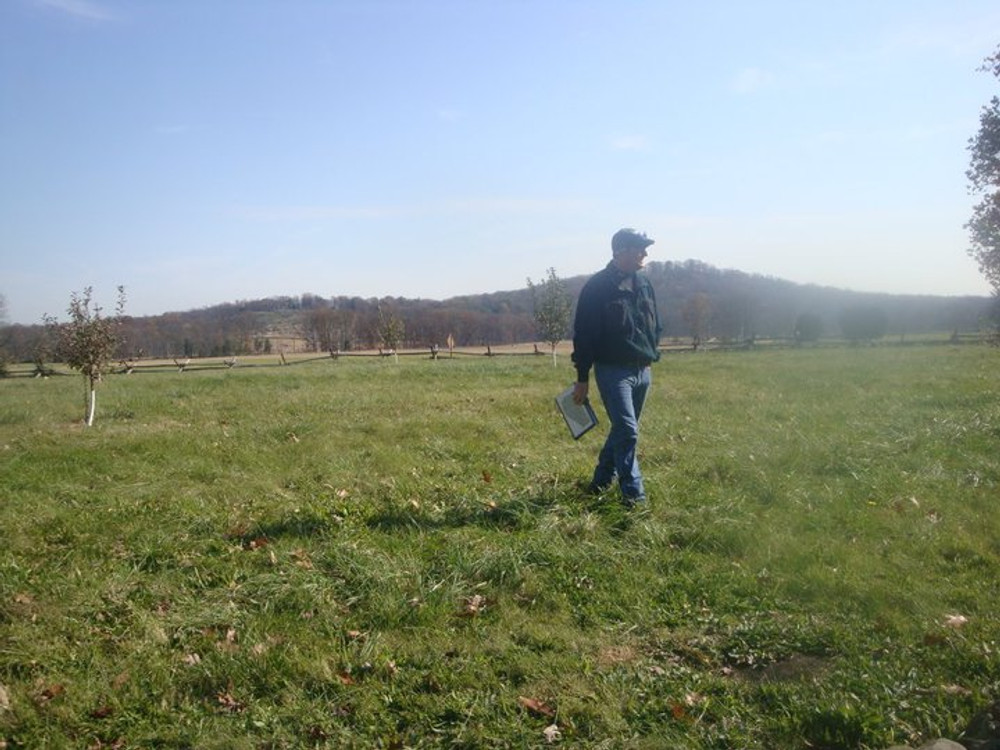 Rick Allen, with the Round Tops looming behind him, leading a tour Anderson's brigade at Gettysburg.