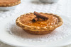 """Perfectly harvested North Carolina Jumbo Yams whipped together with the finest spices, European style butter and pure flavor extracts make the best sweet potato pie.  And a slowly mixed pastry flour dough makes the perfect pie crust.  Each box contains 10 individually wrapped (4"""") pies."""