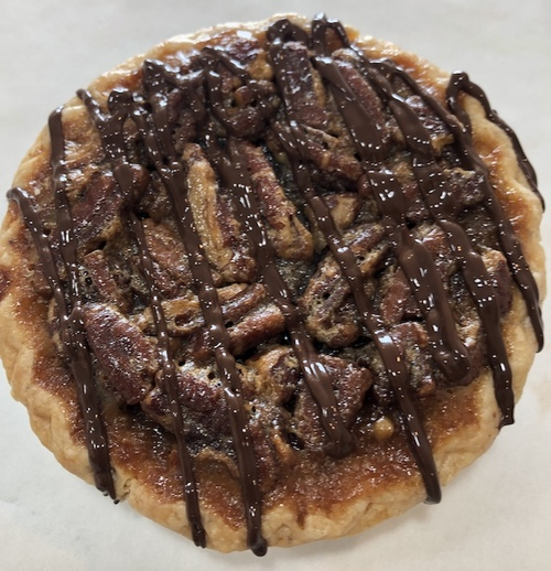 The perfect blend of light and dark corn syrup, premium European style butter, Belgian chocolate morsels, pure extracts and Georgia pecans create an incredible filling.  Each pie (10) is individually packaged to ensure freshness.