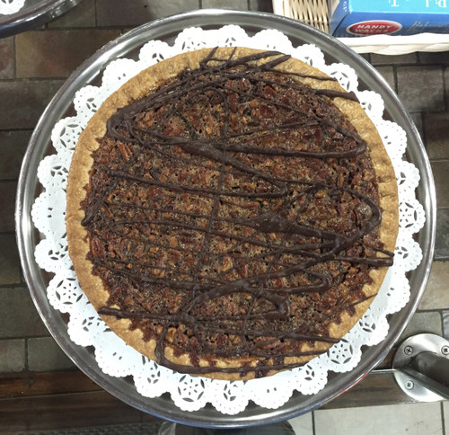 """The perfect blend of light and dark corn syrup, premium European style butter, Belgian chocolate morsels, pure extracts and Georgia pecans create an incredible filling.  Each pie is 10"""" and serves 8-10 slices."""