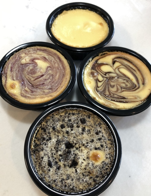 Philadelphia Cream Cheese slowly whipped into a smooth batter with a hint of fresh lemon zest mixed in.  Baked in a water to create a dense, New York style delight.  Includes (2) Plain (2) Strawberry 2) Chocolate Swirl (2) Raspberry Swirl (2) Oreo.