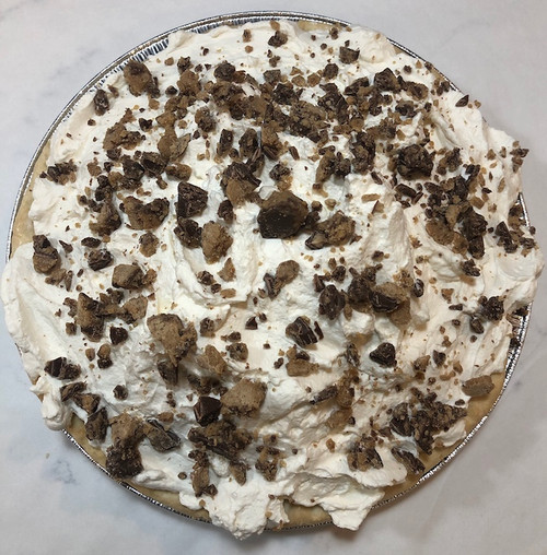 """Premium Belgian chocolate, finely chopped Reese's peanut butter cups, slowly melted in a sauce pan filled with milk, organic eggs, European style butter and pure extracts sit atop a handmade crust.  Heavy cream (40%) spun ever so gently with powdered sugar and pure vanilla makes the perfect whipped cream topping.  Each pie is 10"""" and serves 8 slices.  ONLY AVAILABLE FOR LOCAL DELIVERY.  CAN NOT BE SHIPPED VIA UPS."""