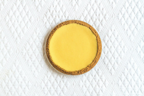"""Hand squeezed fresh key limes slowly mixed with sweetened condensed milk, organic eggs and lime shavings, poured into a handmade buttery graham cracker crust.  Each pie is 10"""" and serves 8-10 slices.  ONLY AVAILABLE FOR LOCAL DELIVERY.  CAN NOT BE SHIPPED."""