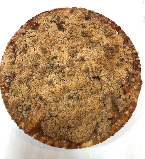 """Plump sliced peaches hand tossed with premium spices, extracts and butter and baked underneath a buttery crumb topping.  Each pie is 10"""" and serves 8-10 slices.  ONLY AVAILABLE FOR LOCAL DELIVERY.  CAN NOT BE SHIPPED VIA UPS."""