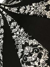 Close up of white band black bat damask pattern on umbrella.