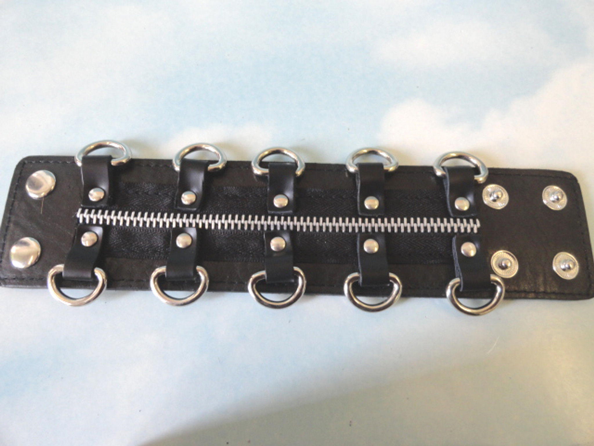 Black leather bracelet with zipper and D rings