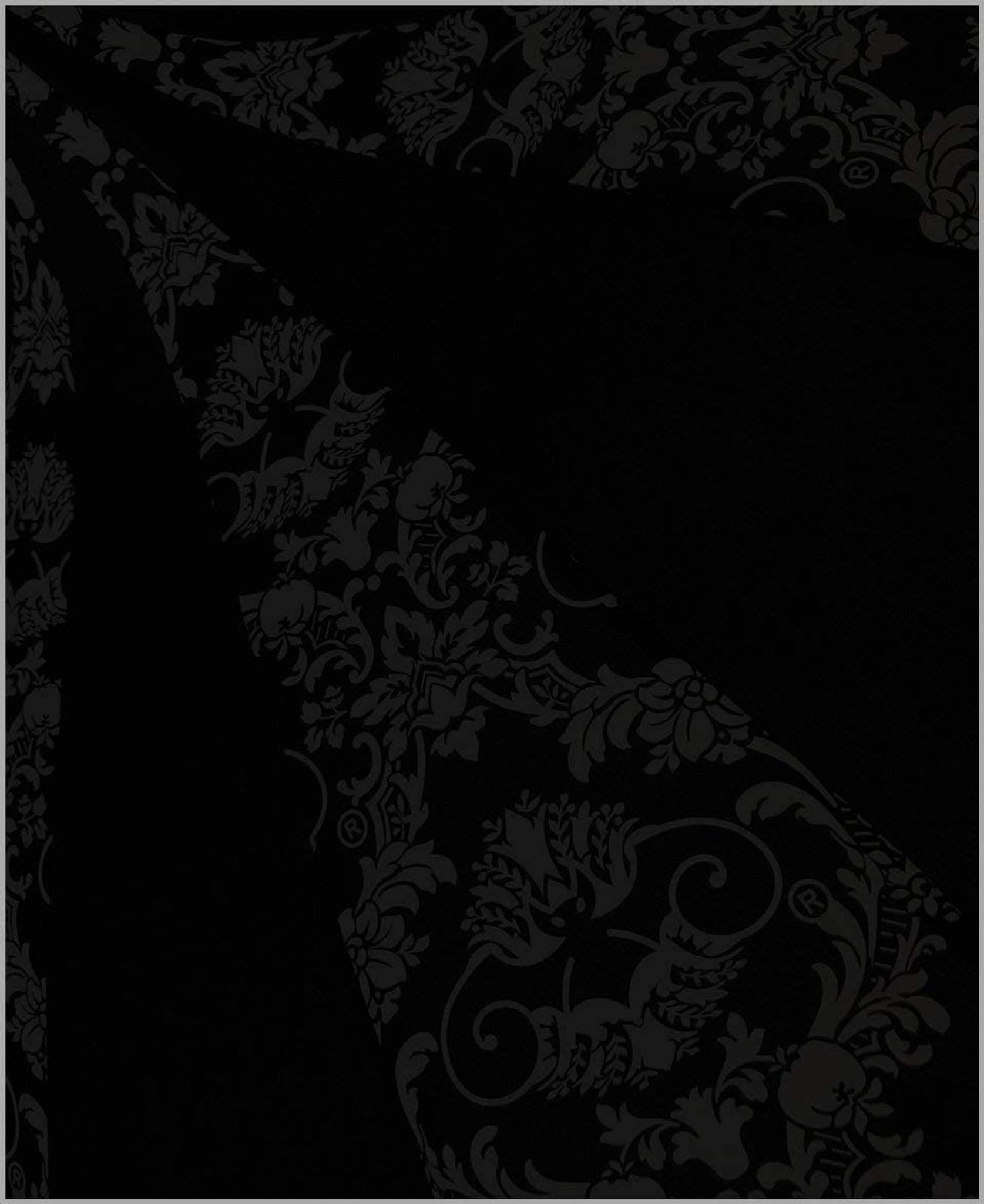 Close up of black bat damask print on black umbrella/parasol.