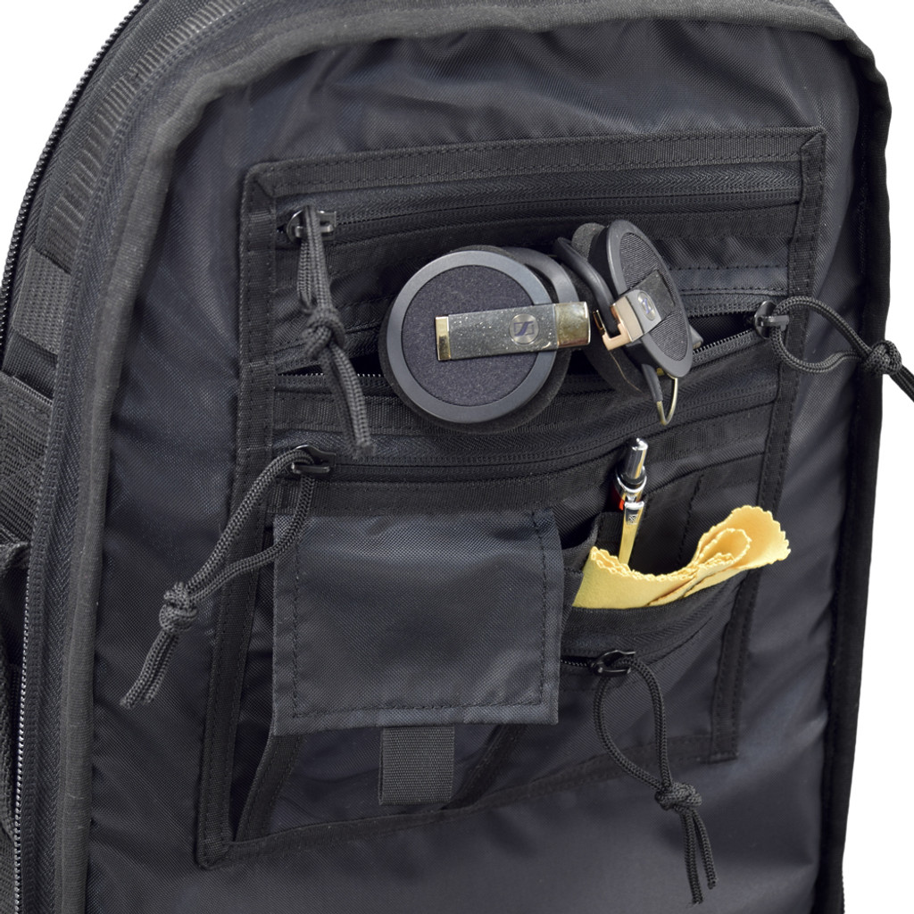 Organizer panel with multiple pockets for smaller items