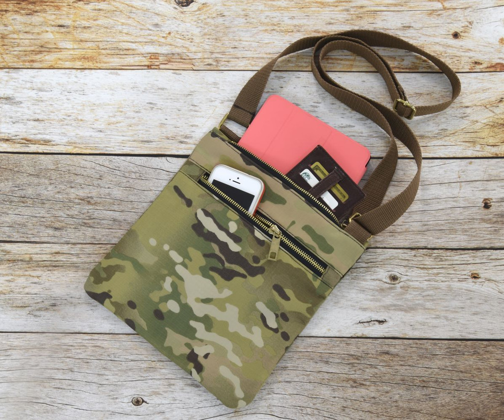 Large zippered top and front pockets provide just enough room to carry the essentials on the go without weighing you down
