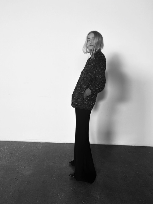 Kelly Atkinson Showroom-X Creative Director in Song For The Mute Collarless Patch Jacket, Paris Georgia Standard Issue Turtle Neck and Song For The Mute Bias Cut Pant
