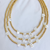 3 Gold bead and pearl initial necklaces with heart and star accents