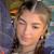 Darianka wearing white mini eye heart you