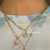 wearing glitzy smile necklace layered with others