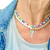 Wearing stacked neckalces