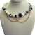 Just Wanna Have Fun Necklace Blackberry on Stand Background Zoom Out