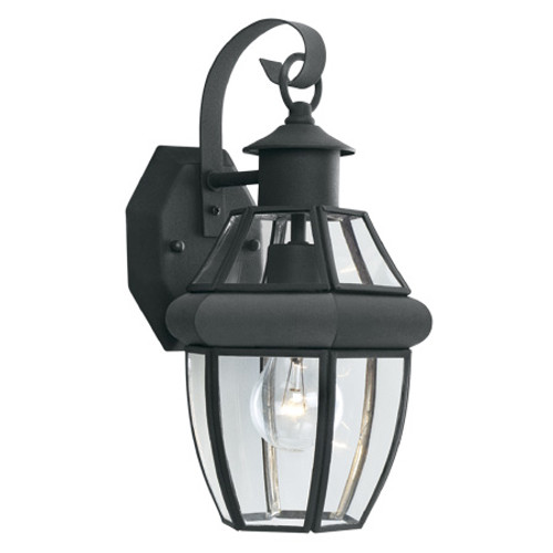 Outdoor Lights By Thomas One-light traditional outdoor wall lantern with clear glass panels and rounded molding in a Brushed SL941378
