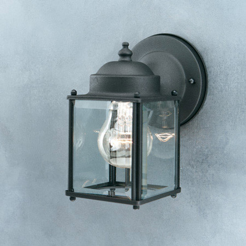 Outdoor Lights By Thomas Essentials 7.5in One-light Black finish outdoor wall lantern with clear beveled glass panels. SL94697