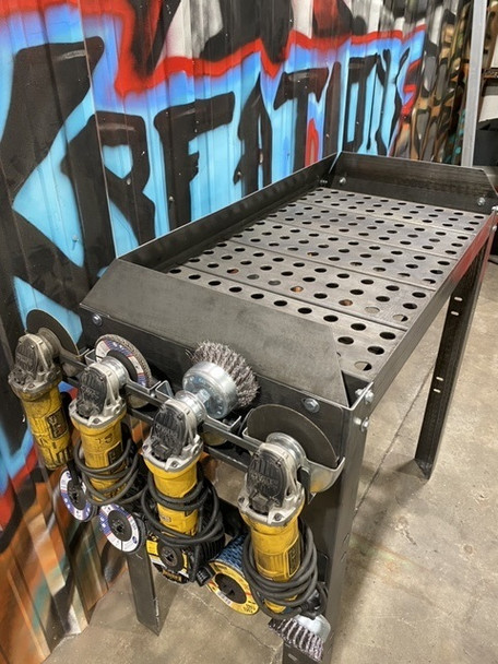"""This table is designed with the fabricator in mind, it allows you to spend more time working making money and less time cleaning up the mess. The sides of the table are designed to contain 80% or more of grinding debris to a single area rather than the entire shop.      Details:  This table is 100% bolt together and features a 40""""x 20"""" usable grinding surface. The slats have holes to allow for part hold downs and are also removable for cleaning or weird shaped items. slats can also be reversed to create a slat table for plasma or flame cutting. Table surface is 36"""" tall. table comes in bare metal.     **optional accessories**  - Grinder rack(4 4-1/2 grinders)  - Abrasive disk rack(holds up to 50 abrasive disks)  - Storage tray  - Single grinder rack        FREE SHIPPING"""