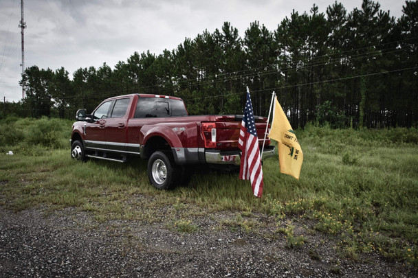 """No need to drill holes in the bed of your truck! simple installation of our hitch into a standard 2"""" receiver will have you on the road in minutes! The hitch has bolts for tightening down the flag pole and holding everything securely in place.  This product is proudly made in the USA!!  Comes stock in Matte Black.  Fits 1"""" pole for flag"""