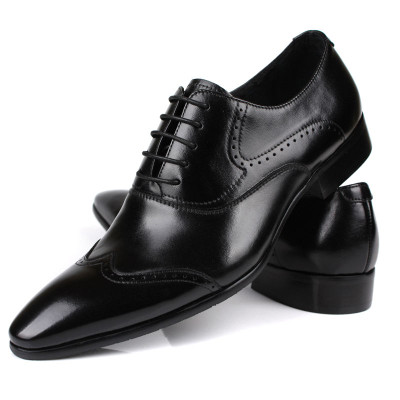 Black pointed brogue shoes