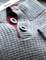 Button and Pattern Detail of Ribbed Fisherman Sweater With Button Collar