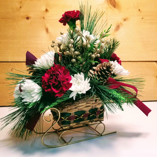 Christmas Sleigh (SCF17C28) by Savilles Country Florist.  Christmas Flower Arrangements, Centerpieces and Plant delivery to Orchard Park, NY and the surrounding area including same day delivery to Hamburg, West Seneca, East Aurora, Blasdell and Buffalo NY