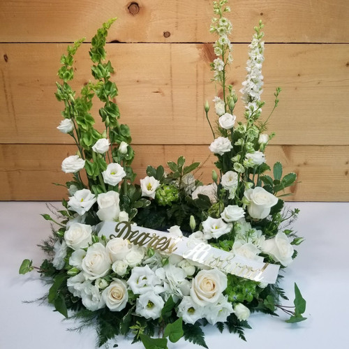 Heaven's Garden Wreath (SCF18SY103) by Savilles Country Florist.  Flower and Plant delivery to Orchard Park, NY and the surrounding area including same day delivery to Hamburg, West Seneca, East Aurora, Blasdell and Buffalo NY