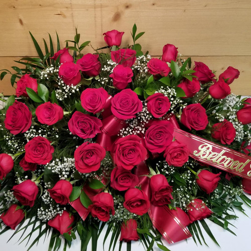 Red Rose Casket Spray (SCF18SY113) by Savilles Country Florist.  Flower and Plant delivery to Orchard Park, NY and the surrounding area including same day delivery to Hamburg, West Seneca, East Aurora, Blasdell and Buffalo NY