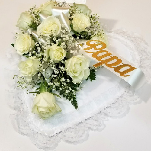 White Rose Casket Pillow (SCF18SY116) by Savilles Country Florist.  Flower and Plant delivery to Orchard Park, NY and the surrounding area including same day delivery to Hamburg, West Seneca, East Aurora, Blasdell and Buffalo NY