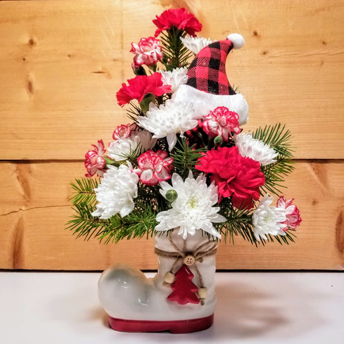 Santas Boot (SCF19C01) by Savilles Country Florist.  Christmas Flower Arrangements, Centerpieces and Plant delivery to Orchard Park, NY and the surrounding area including same day delivery to Hamburg, West Seneca, East Aurora, Blasdell and Buffalo NY