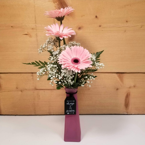 Message in a Bottle - Pink Gerbs (SCF20D06) by Savilles Country Florist.  Flower and Plant delivery to Orchard Park, NY and the surrounding area including same day delivery to Hamburg, West Seneca, East Aurora, Blasdell and Buffalo NY