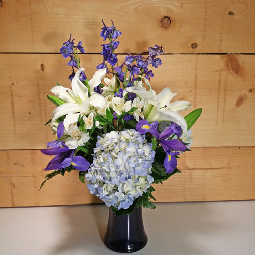 Beautiful in Blue Bouquet by Savilles Country Florist. Flower delivery to Orchard Park, Hamburg, West Seneca, East Aurora, Buffalo, NY and surrounding suburbs.