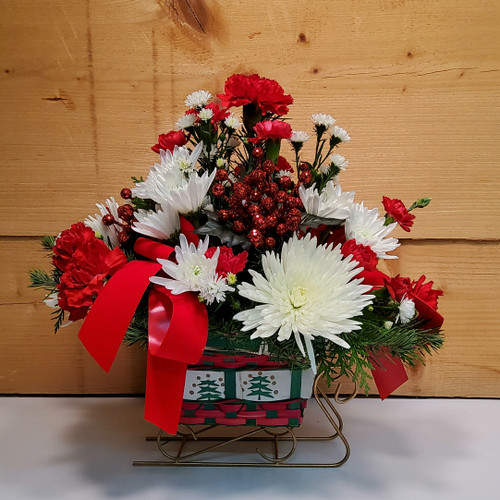 The Festive Sleigh Basket (SCF17C16) by Savilles Country Florist.  Christmas Flower Arrangements, Centerpieces and Plant delivery to Orchard Park, NY and the surrounding area including same day delivery to Hamburg, West Seneca, East Aurora, Blasdell and Buffalo NY