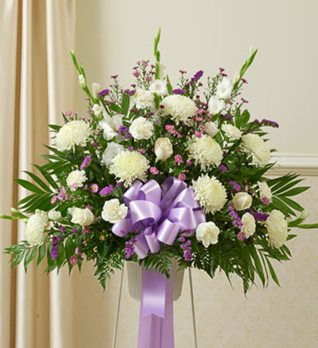 Small Heartfelt Sympathies Lavender Arrangement by Savilles Country Florist. Flower delivery to Orchard Park, Hamburg, West Seneca, East Aurora, Buffalo, NY and surrounding suburbs.