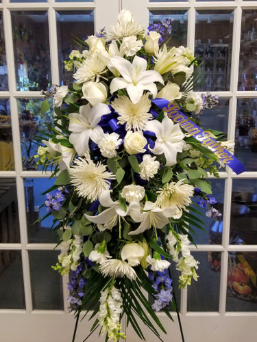 White & Blue Sympathy Standing Spray by Savilles Country Florist for delivery to Orchard Park, Hamburg, West Seneca, East Aurora, Buffalo, NY and surrounding suburbs.