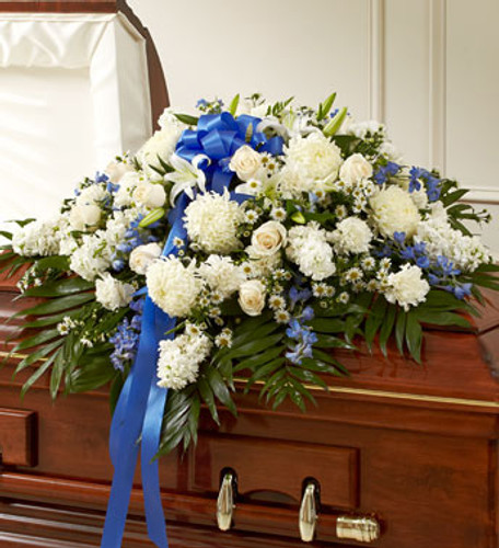 Blue & White Cherished Rose Half Casket Spray by Savilles Country Florist. Flower delivery to Orchard Park, Hamburg, West Seneca, East Aurora, Buffalo, NY and surrounding suburbs.