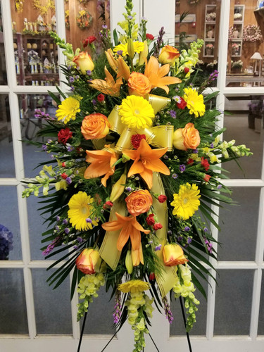 Bright Sympathy Standing Spray by Savilles Country Florist. Flower delivery to Orchard Park, Hamburg, West Seneca, East Aurora, Buffalo, NY and surrounding suburbs.