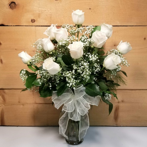 Rose Elegance White by Savilles Country Florist. Flower delivery to Orchard Park, Hamburg, West Seneca, East Aurora, Buffalo, NY and surrounding suburbs.