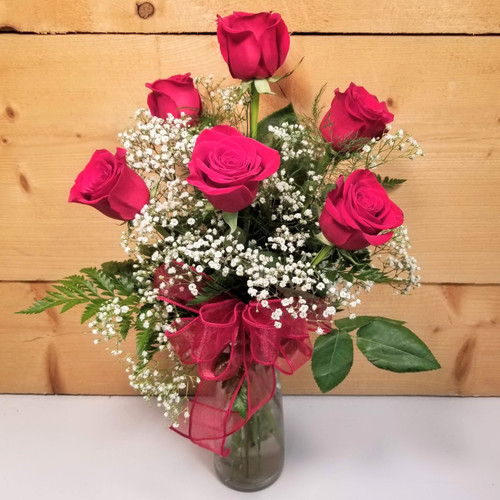 Love's Embrace Red (1030) by Savilles Country Florist.  Flower and Plant delivery to Orchard Park, NY and the surrounding area including same day delivery to Hamburg, West Seneca, East Aurora, Blasdell and Buffalo NY